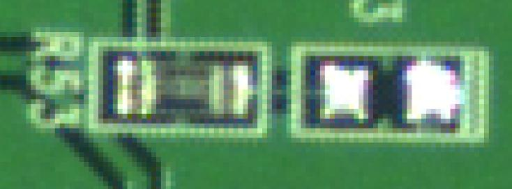 Photo of a printed circuit board taken with the Aptina 5 megapixel color sensor / Kowa JC10M lens, zoomed by 1950 percent