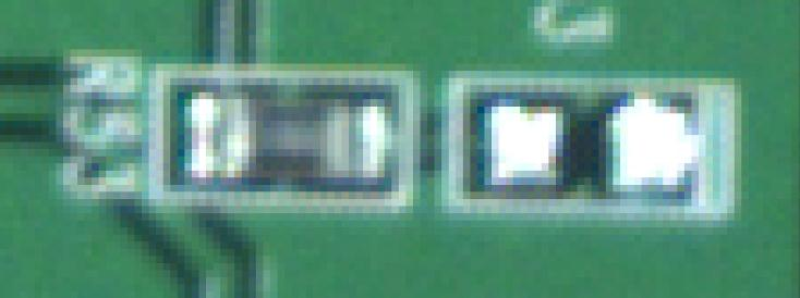 Photo of a printed circuit board taken with the Aptina 5 megapixel color sensor / Kowa JCM lens. Picture was zoomed by 1950 percent.